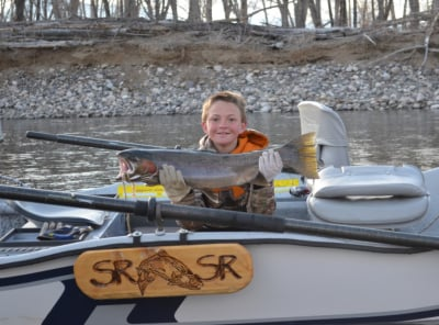One of my better fishing partners, and a future guide, with a nice steelhead